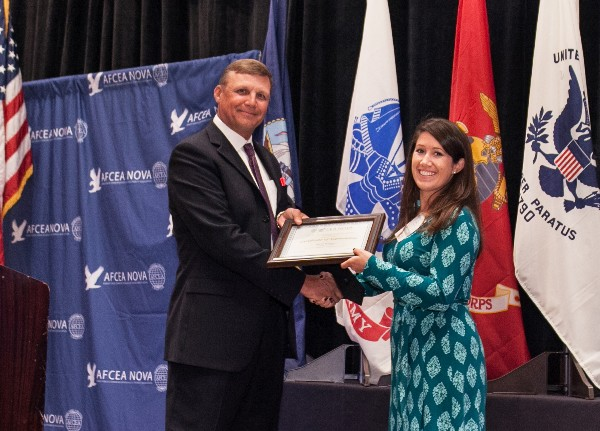 Sarah Williams receives the Emerging Young AFCEAN Award from Zich in September.