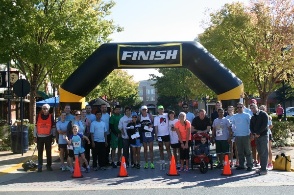 The race director, committee members and race winners join together at the finish line in September.