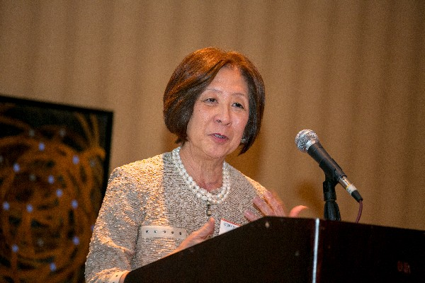 Teri Takai, chief information officer, U.S. Defense Department, addresses the chapter at its Women in NOVA Fall Networking Social in October.