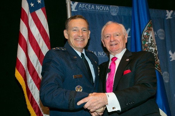 Keynote speaker Lt. Gen. Michael J. Basla, USAF, and Chuck Corjay, event lead, gather for the 12th Annual Air Force IT Day in December.