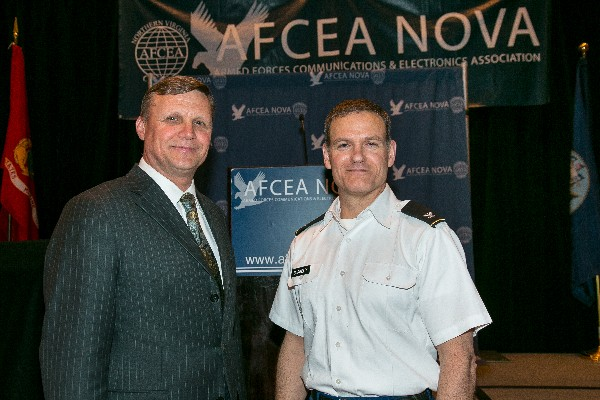 Col. Ken Blakely, USA, commander, Command and Control Support Agency, joins Ron Zich, chapter president, following the colonel's speech at the March luncheon.