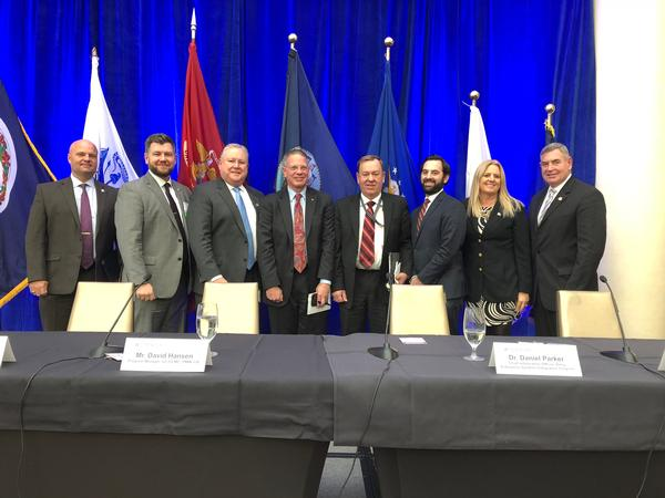 Panelists and others participating in a November chapter luncheon focused on logistics modernization gather for a photo.
