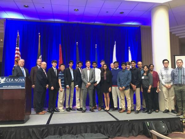 Gary Wang, the U.S. Army's deputy chief information officer/G-6 (c), gathers with chapter leaders and science fair award winners for a group photo at the May luncheon.