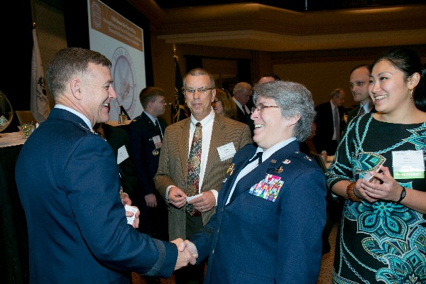 Together at Air Force IT Day in December are speakers Lt. Gen. Burton M. Field, USAF, and Brig. Gen. Linda R. Urrutia-Varhall, USAF.