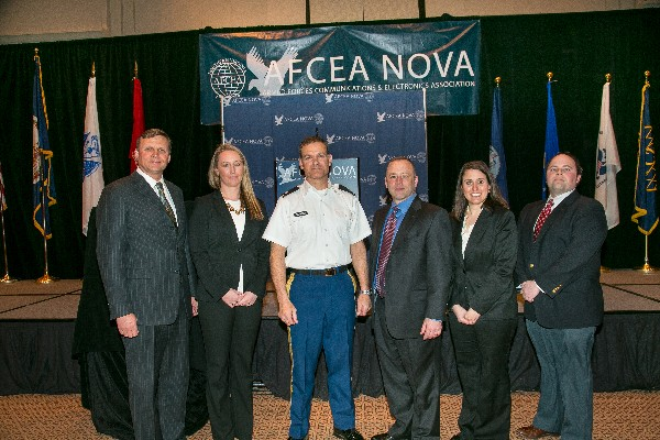 Together at the March luncheon are (l-r) Ron Zich, chapter president; Fiona Wass, Deltek; Col. Ken Blakely, USA, guest speaker and commander, Command and Control Support Agency; Tim Patch, Sagent Partners; Cara Odlen, ANU Professional Training; and Dave Fraley, Paragone Solutions.