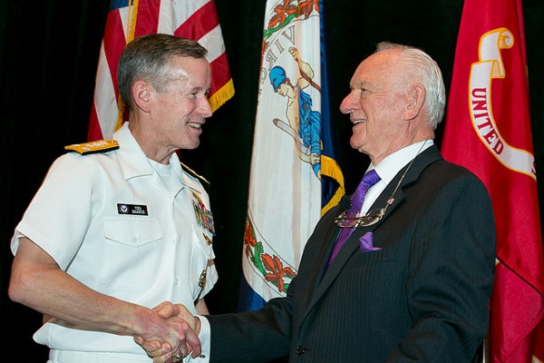 Vice Adm. Ted Branch, USN, deputy chief of Naval Operations for Information Dominance and director of Naval Intelligence (l) greets event chair Chuck Corjay during June's Naval IT Day.