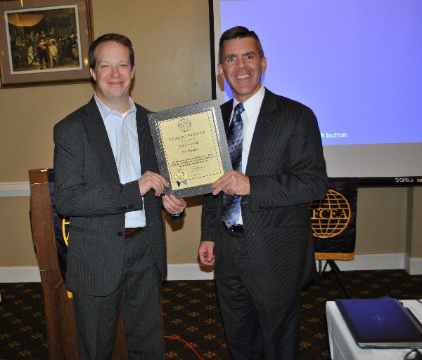 In October, Paul Reimers (r), chapter president, presents a Life Member certificate to Wes Nagel, a member of the chapter's board of directors.