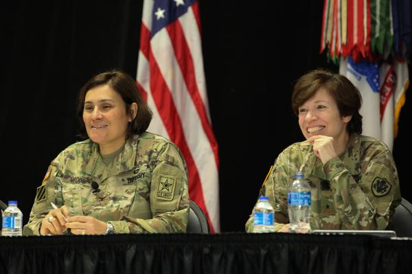 Col. Nora Marcos, USA (l), and Brig. Gen. Maria Barrett, USA, deputy director of operations, U.S. Cyber Command, speak at the Women in Technology Panel during TechNet Fort Bragg in April at the Crown Complex in Fayetteville, North Carolina.