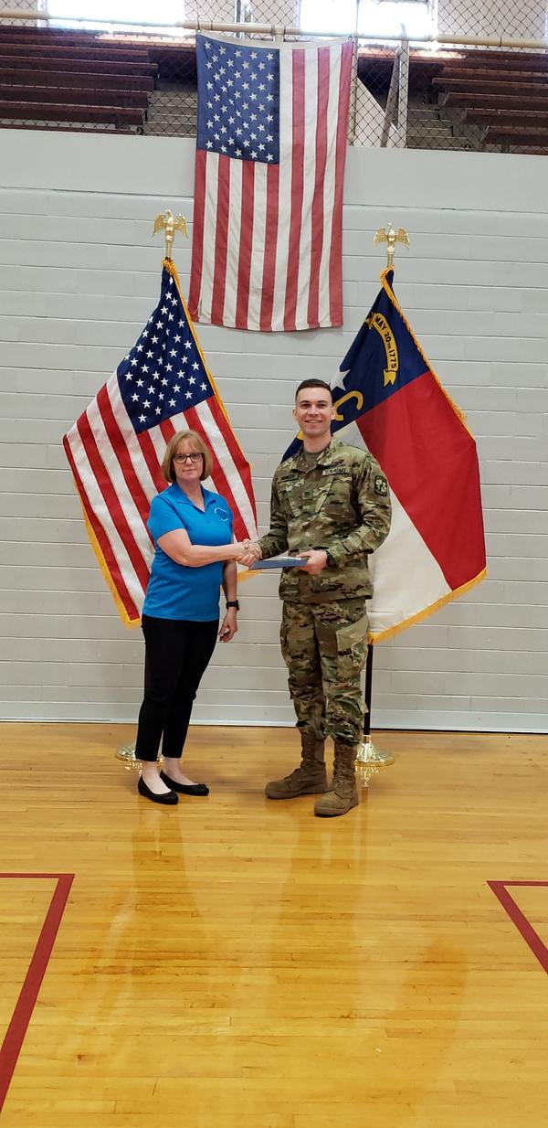 Chapter representative Georgia Popp presents Cadet Elijah Paynter, junior ROTC, East Carolina University, the AFCEA International ROTC Honors Award for 2019 in recognition of his achievements in leadership and academics at the March event.