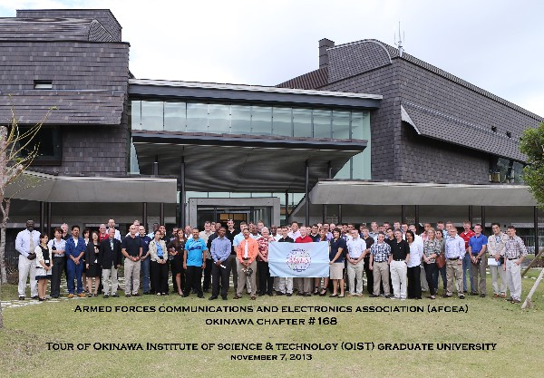 Attendees gather for the November tour of the Okinawa Institute of Science and Technology (OIST) Graduate University, including Tim Dyce, chief information officer for the institute, Community Relations staff and Master Gunnery Sgt. Arthur Allen III, USMC (far left), chapter president, who is the G-6 communications chief for III Marine Expeditionary Force.