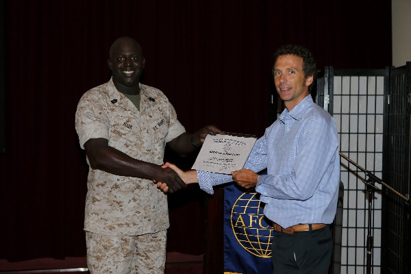 Master Gunnery Sgt. Arthur Allen III, USMC, chapter president (l), presents a certificate of appreciation to Alan