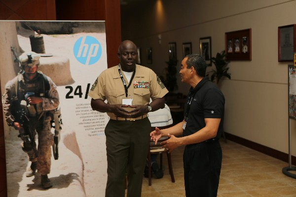 At TechNet in September, Master Gunnery Sgt. Arthur Allen III, USMC, communications chief, III Marine Expeditionary Force and the chapter's first enlisted president, interacts with Moriyoshi Nixon, a corporate representative of WESCO/CSC.