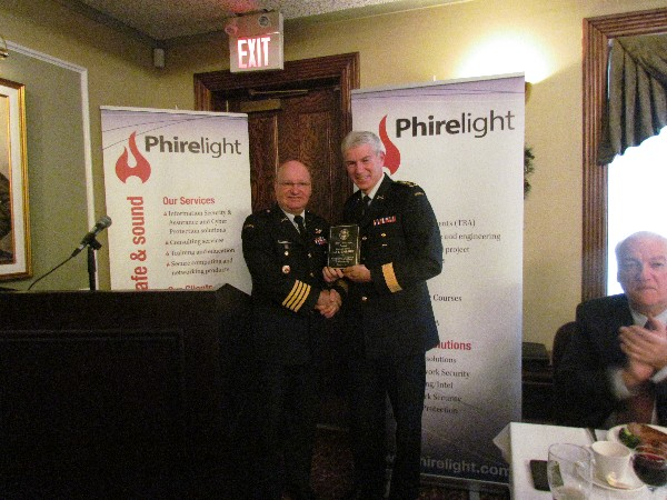 Col. Martin Girard, Canadian Armed Forces (l), chapter president, presents a token of appreciation to the December luncheon speaker Lt. Gen. Guy R. Thibault, Canadian Armed Forces, vice chief of the Defense Staff.