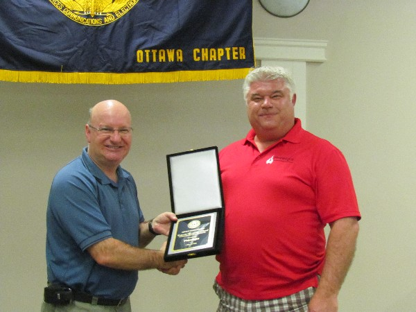 In May, Col. Martin Girard, DND (CFSSG), chapter president (l), presents Phirelight representative Doug Kirkpatrick with a Corporate Sponsorship award for the 2013-2014 year.