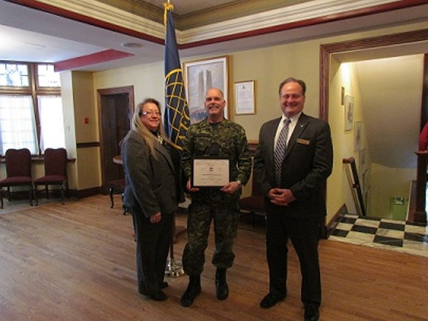 Chapter President Kelly Stewart-Belisle and Vice President of Programs Dave Johnson greet Lt. Col. Donald Mulders of the Department of National Defence after his speech on current challenges for the Canadian Joint Operations Command at the February luncheon.