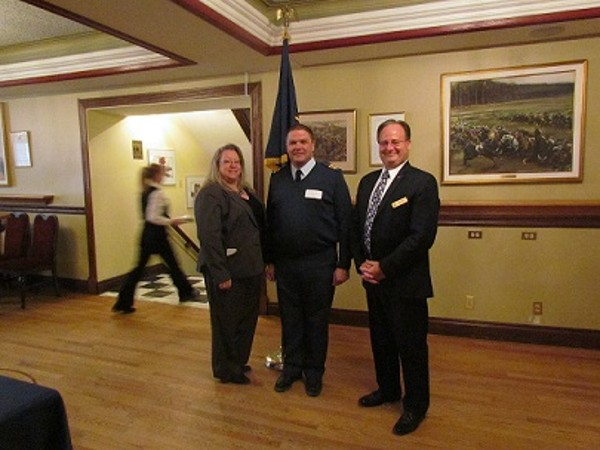 Together at the March meeting are (l-r) Kelly Stewart-Belisle, chapter president; Lt. Col. Nick Torrington-Smith, CAF, guest speaker; and Dave Johnson, chapter vice president of operations.