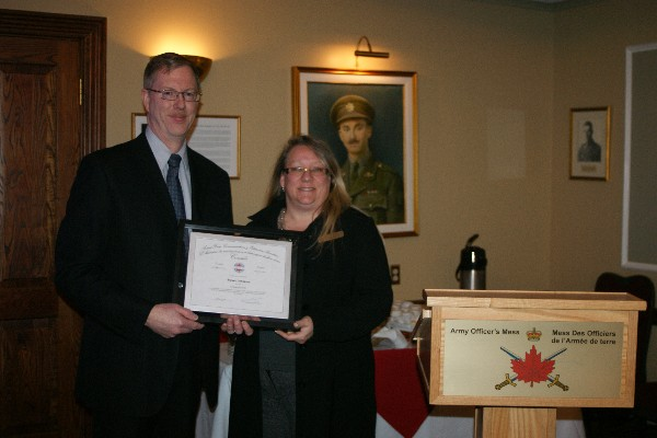 Kelly Stewart, regional vice president, presents a certificate to the chapter�s January luncheon speaker, Steven Johnston, senior security and technical adviser, Office of the Privacy Commissioner of Canada.