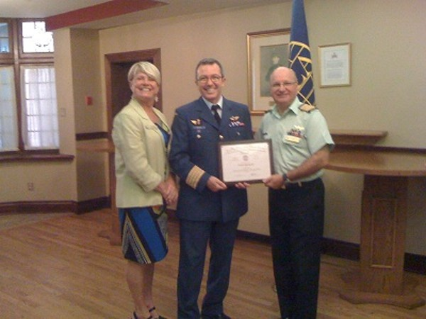 Laurie Mack, chapter vice president for programs, joins Col. Boucher (c) and Col. Girard at the September luncheon.