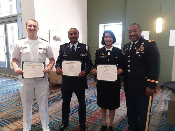Maj. James Crenshaw, deputy air and missile defense chief, U.S. Army Central/G-39 and chapter secretary, presents scholastic awards on behalf of AFCEA International to (from l) Midshipman Brooks E. McNeal, Cadet Leon E. Davis and Cadet Aditi R. Tailor at an April ceremony.