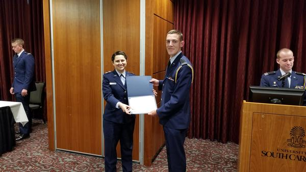 Maj. Vanessa Gonzalez, USAF (l), chapter 2nd vice president, presents the AFCEA International Scholastic Awards to Air Force Cadet Austin C Horton at the April ceremony.