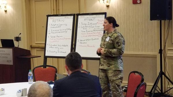 Lt. Col. Elizabeth M. Popiak, USA, deputy director, Office Chief of Cyber, U.S. Army Cyber School, acts as the Attract and Recruit chairperson by guiding and collecting key points of the conversation from the group at the January event.