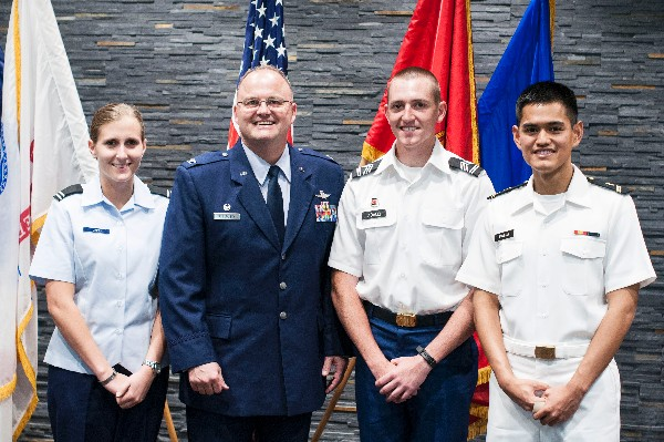 Receiving AFCEA International awards from Col. Joseph A. Sublousky, USAF, chapter president, at the University of South Carolina in April are Cadet Ashley N. Zapp, Air Force ROTC; Cadet Justin A. Adams, Army ROTC (2nd from r); and Midshipman Larry W. Pineda, Navy ROTC
