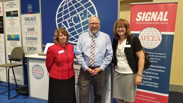 AFCEA International's (l-r) Sandy Campbell, Sean McGowan and Susan Emert sign up new members at the August conference.