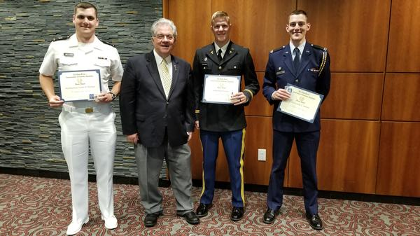 Jim Crawford (center l), chapter director of member services, congratulates award winners (l-r) Midshipman Adam D. Wellner, Army Cadet Peter Leichner and Air Force Cadet Austin C. Horton after the April ceremony. Midshipman Wellner is off to NAS Pensacola, Florida; Cadet Lecihner will attend medical school to become an Army doctor; and Cadet Horton is going to flight school. The chapter wishes them all the best in their new careers.