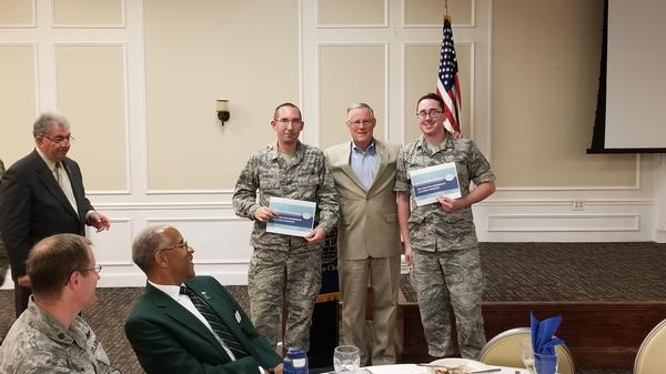At the September luncheon, Gen. Shea (c) presents a one-year AFCEA membership and a subscription to SIGNAL Magazine to Airman 1st Class Kyle Bowers, USAF (l), and Airman 1st Class Ryan Huber, USAF, both from the 20th Communications Squadron, Shaw Air Force Base.
