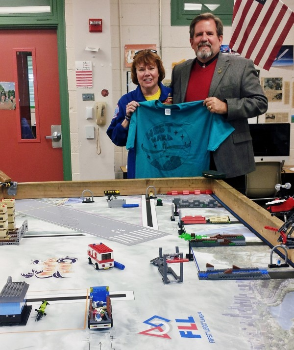 Dr. Kerry Crooks (r), an Airman's Medal awardee, visits Adams at West Ward Elementary School to view the school's NASA Space Week displays. The school was awarded a $1,000 STEM Teaching Tools grant in October for its outstanding robotics program.