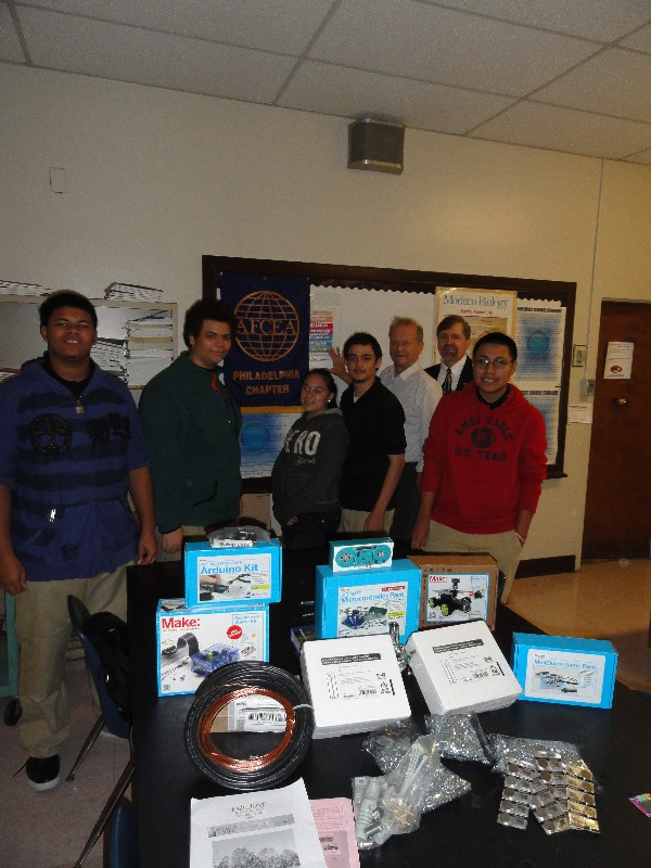 Together at the AFCEA STEM grant presentation in November are (l-r) Woodrow Wilson High School students Josue Soto, Roberto Santiago, Amber Camacho and Alfredo Llorens; Dave Purdon, science teacher, Woodrow Wilson High School, recipient of the 2013 AFCEA STEM grant; Tom Rachfalski, chapter president; and student Jason Roman.