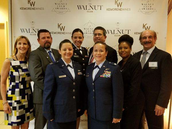 Attending the July Walnut Club Awards banquet honoring local female leaders are (from l) Tina Jordan, AFCEA vice president, membership; Rob Corey, chapter president; Capt. Tanya M. Koch, USAF, director of operations, 436th Communications Squadron; Capt. Jo Anne Schultze, USAR, Judge Advocate General's Corps, and director of operations, USO of Southern New Jersey and Pennsylvania; Chapter Treasurer Mark Meaders; Lt. Col. Stacie A. Rembold, USAF, commander, 436th Communications Squadron; Kristen Davis of Philadelphia's Salvation Army; and AFCEA Regional Vice President Frank Arlotta.