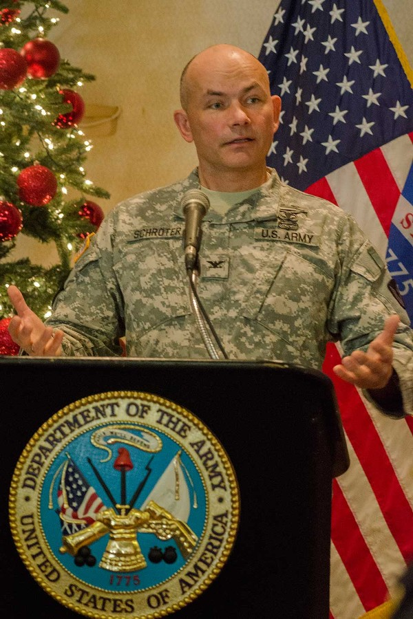"Col. Gerhard Schroter, USA, commander of Tobyhanna Army Depot, delivers a ""State of the Depot"" presentation to the chapter in December."