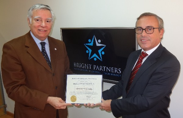 In November, Rear Adm. Carlos Rodolfo, PRT (Ret.) (l), chapter president, presents Eng. Virott da Costa, managing partner of Bright Partners, with a corporate membership certificate.