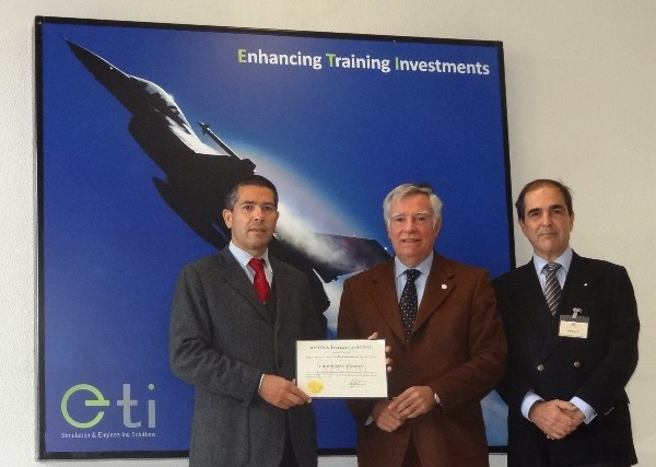 In November, Rear Adm. Carlos Rodolfo, PRT (Ret.) (c), chapter president, presents Carlos Flix (l), chief executive officer, Empordef Tecnologias de Informacao SA (ETI), with a corporate membership certificate in the presence of Maj. Gen. Miguel Rosas Leitao, PRT A (Ret.), chapter vice president.