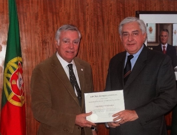 In November, Rear Adm. Carlos Rodolfo, PON (Ret.) (l), chapter president, presents Vice Adm. Jose Torres Sobral, PON (Ret.), National Security Authority, with a corporate membership certificate recognizing the Portuguese National Security Cabinet as member of AFCEA.