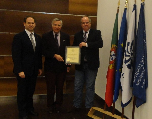 Rear Adm. Carlos Rodolfo, PRT (Ret.) (c), chapter president, presents professor Sergio Vieira da Silva (r), Ph.D., director of the Bachelor of Science in Security Studies at Universidade Lusofona, with a corporate membership certificate in December recognizing ENSINUS - Estudos Superiores S.A. (ISG) as member of AFCEA in the presence of professor Vasco Martins dos Santos.