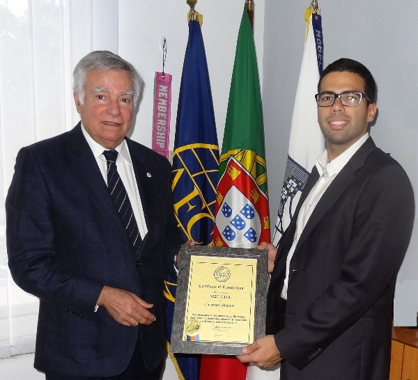 Dr. Hugo Rocha (r), M2C project manager in Portugal, receives a corporate membership certificate from Rear Adm. Carlos Rodolfo, PRT (Ret.), chapter chairman, AFCEA director and regional vice president, Atlantic Region, in November.
