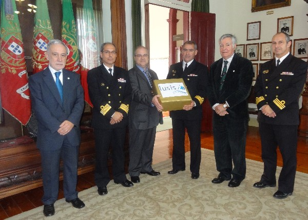 Nuno Paiva (3rd from l), general manager of Lusis Equipamentos e Servicos Lda, presents Cmdr. Castela Repolho (3rd from r), PRT NA, educational director of the Portuguese Navy Technical School, with equipment to support STEM education there. Others gathering for the presentation are (from l-r): Rear Adm. Mario Durao, PRT NA (Ret.), chapter president; Capt. Rodrigues Campos, PRT NA, commanding officer of Escola de Tecnologias Navais; Rear Adm. Carlos Rodolfo, PRT NA (Ret.), AFCEA director and regional vice president, Atlantic Region; and Cmdr. Alcobia Portugal, PRT NA, 2nd commanding officer of Escola de Tecnologias Navais.