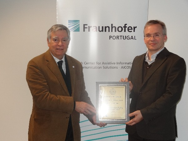 In March, Rear Adm. Carlos Rodolfo, PRT (Ret.) (l), chapter president, presents Professor Dirk Elias, director of Fraunhofer Portugal AICOS, with a corporate membership certificate.
