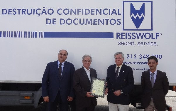 In July, Rear Adm. Carlos Rodolfo, PRT (Ret.) (2nd from r), chapter president, presents a corporate membership certificate to Manuel Cachadinha (2nd from l), president of Reisswolf Portugal Group, in the present of the company directors, Jose Henrique (l) and Miguel Santos.