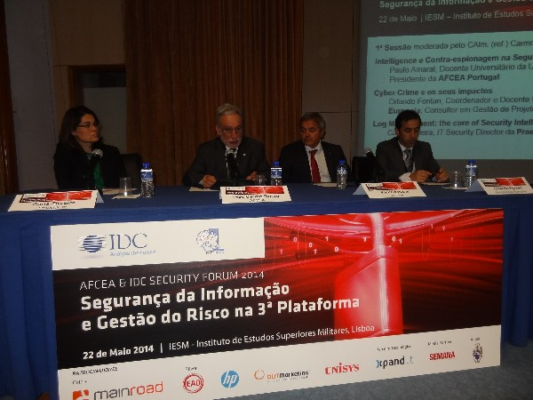 Rear Adm. Mario Durao, PRT NA (Ret.) (2nd from l), moderates a session at the chapter's conference on information security and risk management in May with speakers Carla Zibreira (l), information technology security director, Preasidium; Paulo Amaral, university professor and chapter vice president; and Orland Fontan (r), professor at European University.