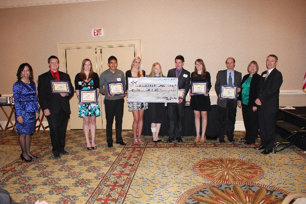 High school scholarship winners and chapter members in May are (l-r) Col. Joyce Jenkins-Harden, USAF (Ret.), chapter executive vice president; Steve Gulliksen; Mikaela Henness-Wilson; Nestor Hernandez; Angela Moser; Clark Mourning; Amy Resman; David Volz (father of recipient Sara Volz); guest speaker Dr. Carol Bach; and Col. Rodney Pohlmann, USAF (Ret.), chapter vice president for education.