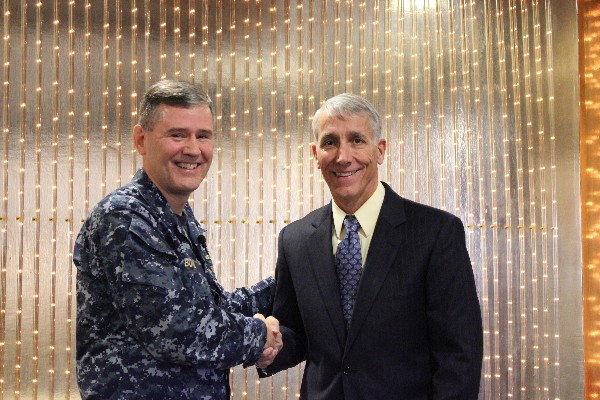 Platt (r) thanks Rear Adm. Thomas H. Hank Bond, USN, director, command and control systems and director of cyberspace operations (J6/J3D), North American Aerospace Defense Command and United States Northern Command, for his remarks at the January meeting.