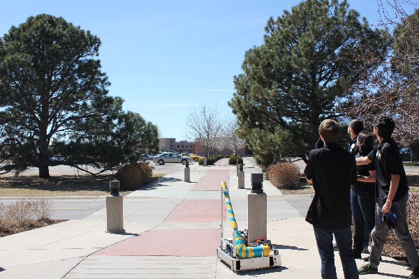 T-Rex—a remotely piloted robot created by the Rocky Mountain Robotics team—launches a T Shirt across the parking lot in March.