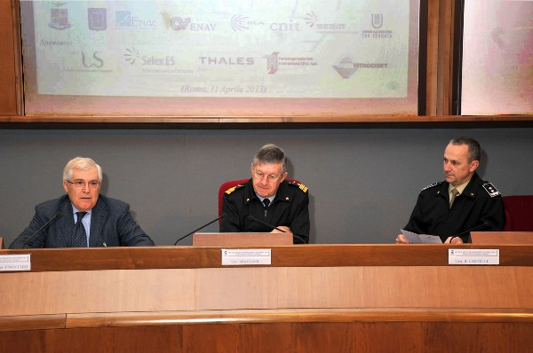 Welcoming the audience to the April conference are Lt. Gen. Carlo Magrassi, ITAF (c), operational commander of Italian Air Force and chairman of the European Union Civil/Military Coordination Committee; Lt. Gen. Pietro Finocchio, ITAF (Ret.) (l), chapter president; and Maj. Gen. Umberto Castelli, ITAF, commander of the School of Transmissions and Informatics of the Italian Army.