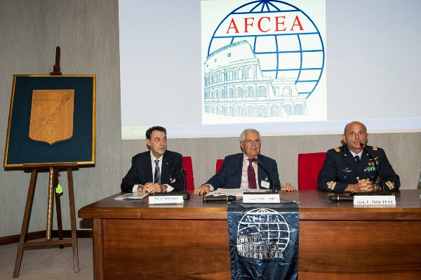 Lt. Gen. Pietro Finocchio, ITAF (Ret.) (c), chapter president and regional vice president, joins Maj. Gen. Fabio Molteni, ITAF (r), commander, Italian Air Force Experimental Center, along with Professor Giovanni Vernazza, CNIT director, during the initial welcome speech in September.