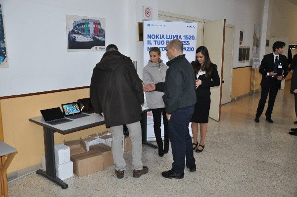 Attendees visit one of the exhibition desks in the homeroom lobby at the chapter�s January workshop on mobile applications.