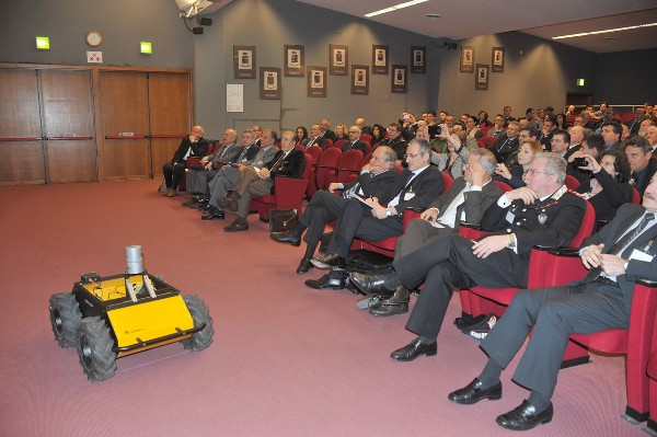 Attendees of the March workshop view a live demonstration of a remotely piloted vehicle in the conference room.