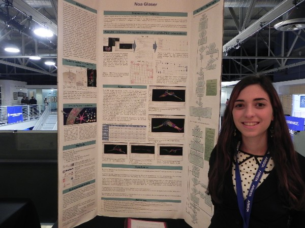 A student showcases her science fair project at a competition in April.